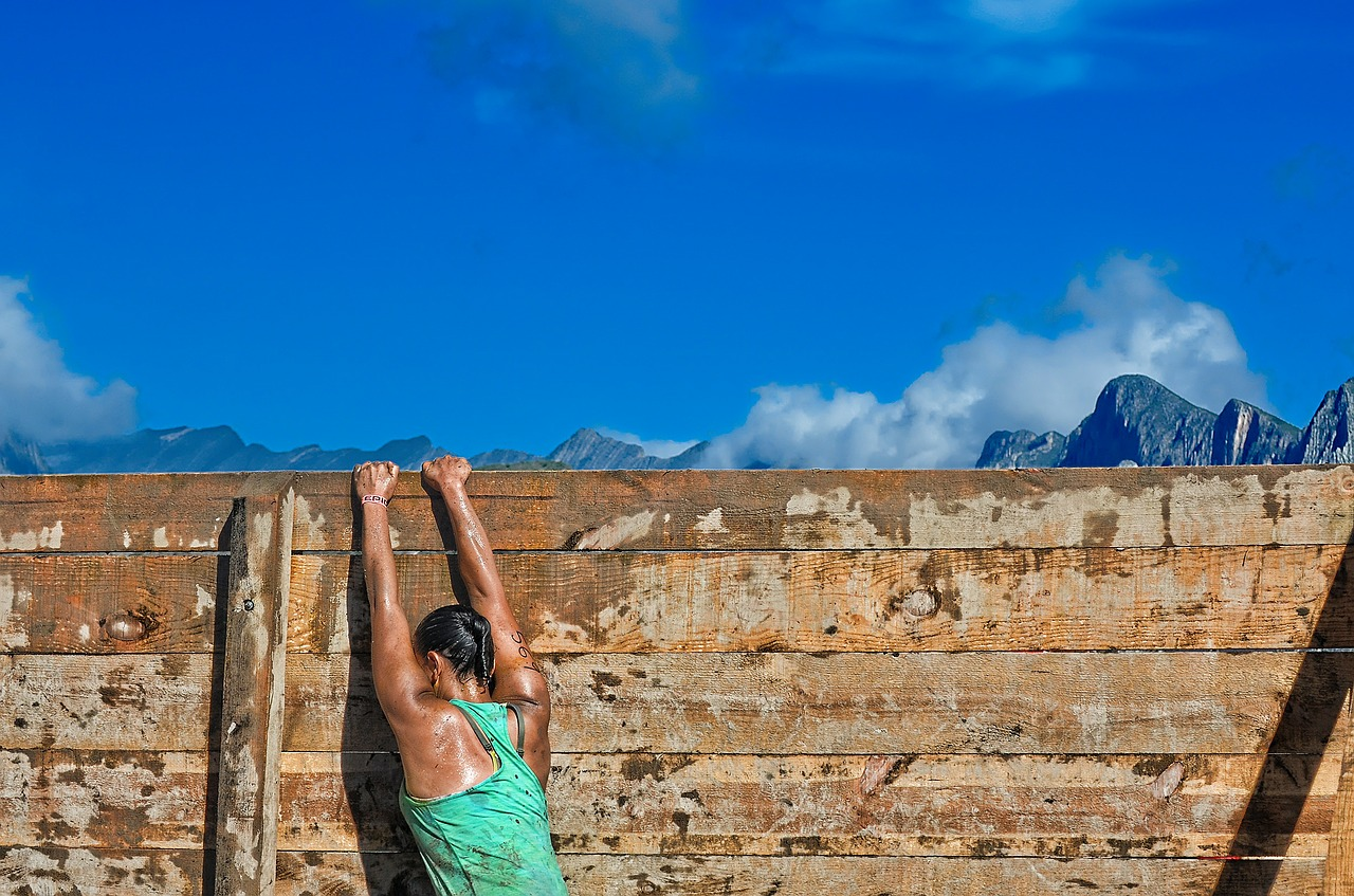 strong woman climbing fence